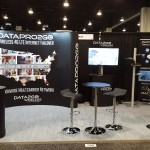 DataPro2Go - 20ft Gullwing, Counters, Retractable banner, SOLO Pronto, and furniture