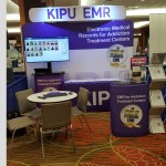 Kipu Systems - 10ft Waveline wall with header, table throw, branded case with lit rack